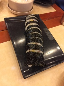 No, it isn't sushi. It's kimbap. What's the difference? Instead of fish, kimbap contains the American delicacy, Spam.